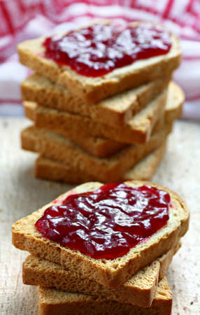 Sandwiches with white bread spread with homemade cherry jam Stock Photo