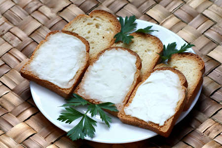 Toasts made from white bread with smooth cheese spread