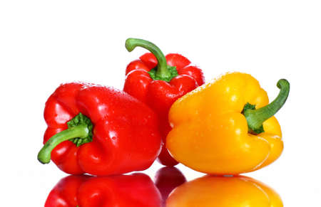Three bell peppers red and yellow on white background with reflection