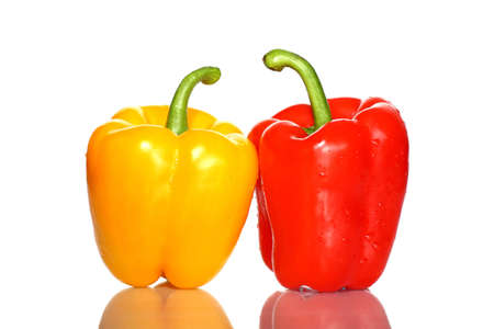 Two bell peppers red and yellow on white background with reflection Stock Photo - 16393820