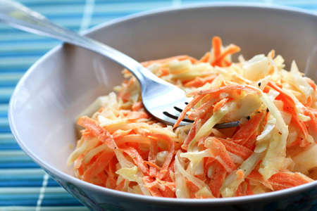 Bowl of salad made of cabbage and carrots close up
