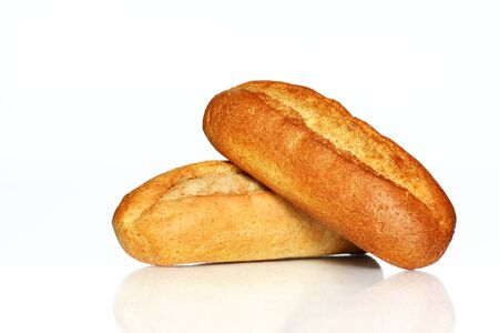 Close up of two bread rolls with reflection on white background Stock Photo