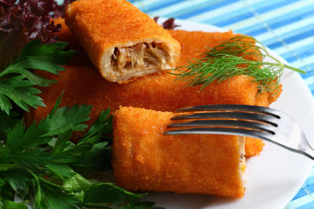 Deep-fried croquettes with mushrooms and white cabbage on the plate Stock Photo