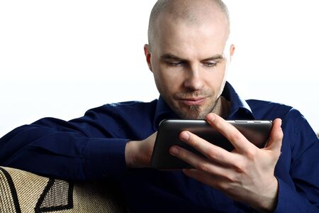 Young guy with computer tablet on white background