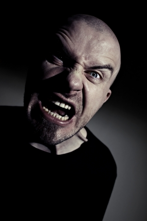 Scary man screaming with angry face