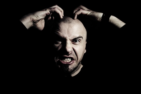 Man with expression of rage on his face Stock Photo