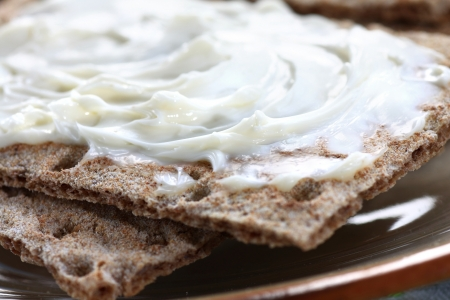 Close up of crispbread slices with cheese spread Stock Photo