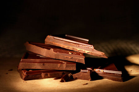 Close up of stacked pieces of dark chocolate Stock Photo - 24909347