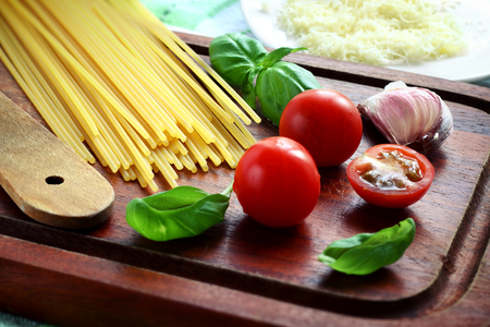 Italian pasta ingredients including spaghetti, tomato, basil, garlic and cheese Stock Photo