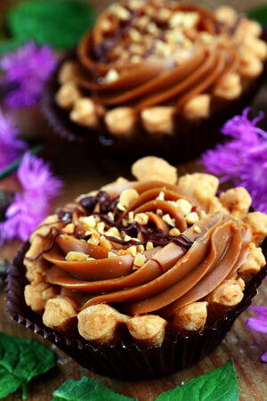 Close up of caramel shortbread cupcakes with nuts Stock Photo