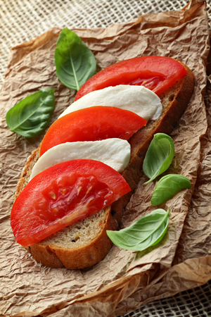 Healthy sandwich with mozzarella cheese and tomatoes