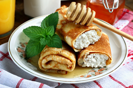Rolled pancakes with cottage cheese close up