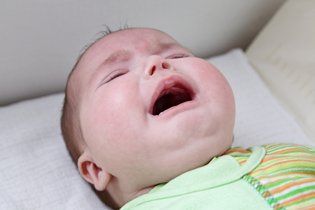 Close up of caucasian baby girl crying face Stock Photo