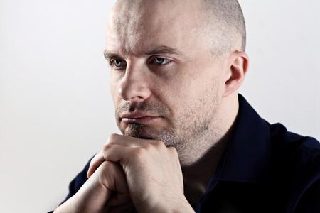 Close up of caucasian man looking upset Stock Photo
