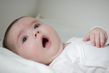 Close up of surprised infant face