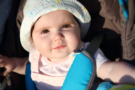 Close up on baby girl smiling face outdoors Stock Photo