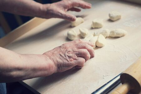 Close up of female hands making dough