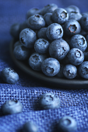 Plate of blueberries close up