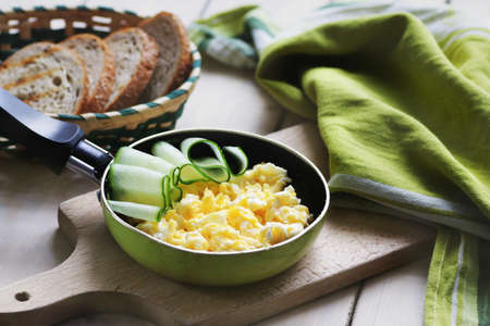 Scrambled eggs in pan Stock Photo
