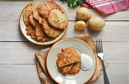Fried hash browns served on a plate overhead view Stock Photo