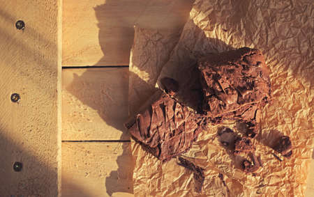 Homemade square brownies cut in pieces top view on a sunny day rustic style Stock Photo