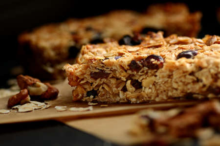 Freshly backed homemade granola bars with nuts and cranberries close up