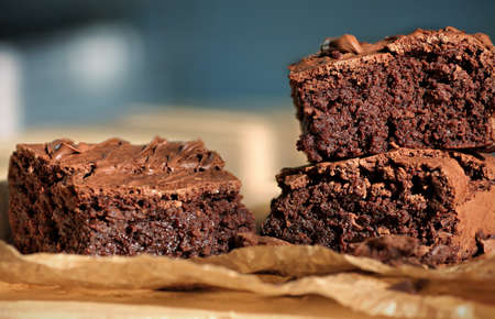 Freshly homemade backed chocolate brownies cut in pieces close up