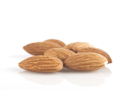 Pile of almonds in isolated white background Standard-Bild