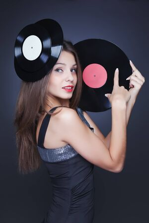 girl with vinyl record on dark background Stock Photo - 12782733