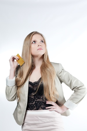Young woman holding a credit card on a white background Stock Photo - 13173089