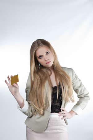 beautiful girl show golden credit card on a white background photo