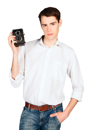 young man with retro camera in hand isolated on white background photo