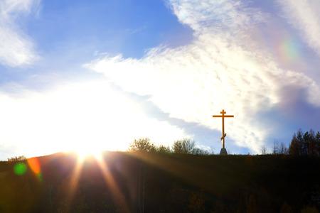 Christian cross on a hill against the sky symbol of faith photo