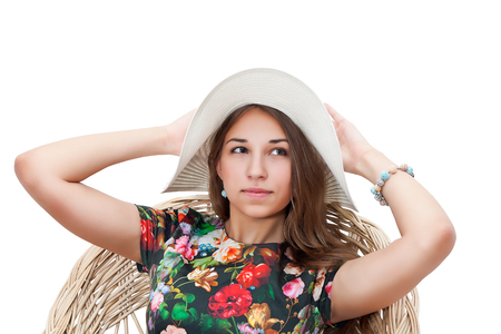 hands behind head: portrait women in summer hat with hands behind head isolated on white background
