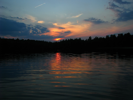 river banks: sunset on the river banks of the forest