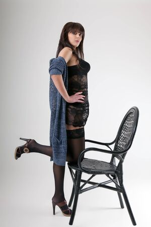 black stockings: brunette in black stockings and negligee posing standing chair