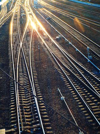 intersect: railroad tracks intersect and shine in the sun