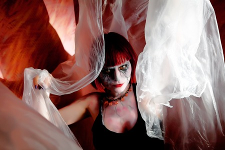 hellion: zombie girl with mystical veil on red wall