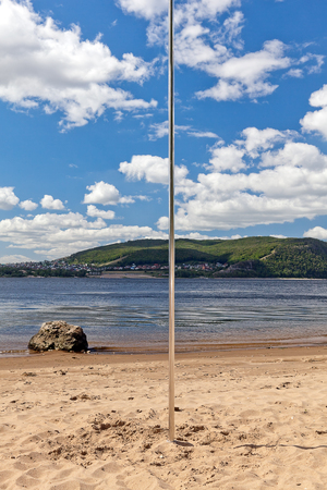 stripper pole: metallic pole for dancing mounted on bank of river beach