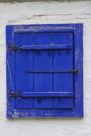 tarnished: Blue antique window with tarnished frame Stock Photo