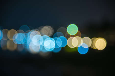 Abstract festive background with colorful bokeh defocused lights