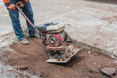 Workers on asphalting and repair of city streets