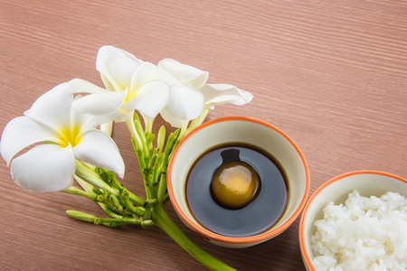 Raw Egg in soy sauce and Plumeria flower,Tamago kake gohan