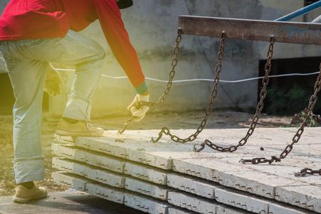 plasterwork: Worker placing cement floor in construction site