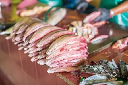 dismantle: Man cutting yellofin fresh fish at male capital town market,Maldives