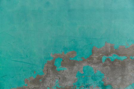 Old green cement wall distressed texture background weathered