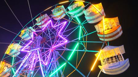 Ferris wheel against with lights neby night lighting. Stock Photo