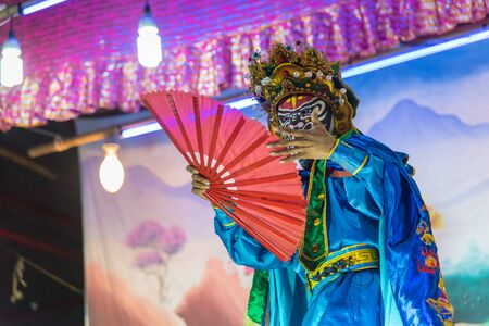 Kalasin, Thailand - December 9, 2017: Actor make up for the performance Chinese opera. Chinese opera is an ancient musical drama at Somdet district Kalasin, Thailand.