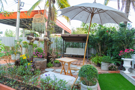 Vintage back yard with outdoor seating.beautiful garden house in country. Stok Fotoğraf