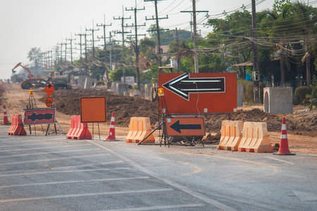 Barricades and signs blocking a road at road construction.Orange funnel Barricades.Road closed signs detour traffic temporary.